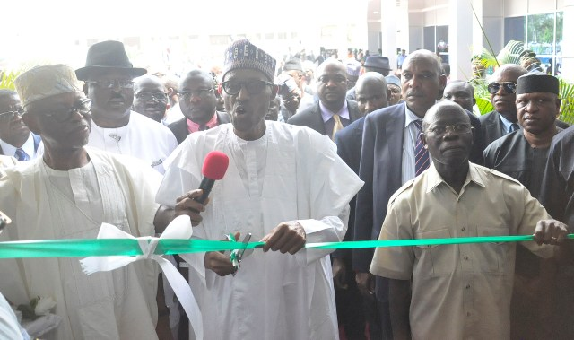 President Muhammadu Buhari cuts the tape to commission the new 200-bed 5-Star Central Hospital in Benin City, flanked by Chief John Odigie-Oyegun, National Chairman All Progressives Congress (APC) (left) and Governor Adams Oshiomhole, on Monday
