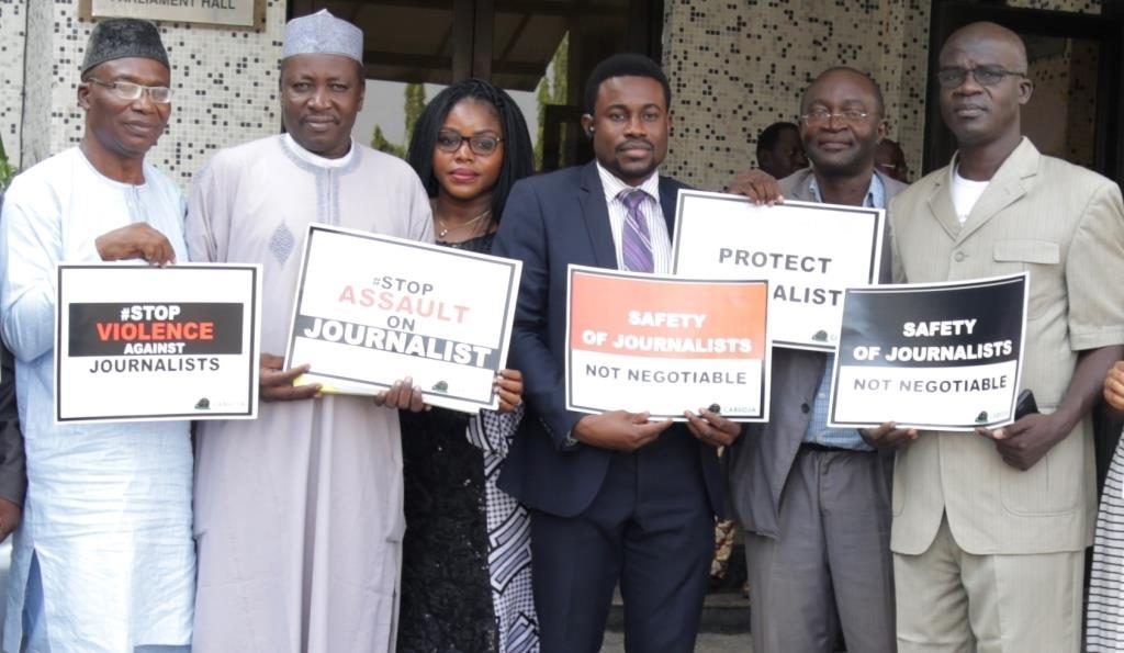 Co founder, CABSOJA, Desmond Utomwen with the National leadership of the Nigerian Union of Journalists and officials