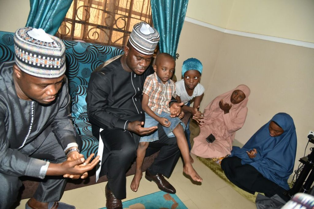 Gov. Bello with the three children of late Lt. Col. Ali and Samira (right) wife of the deceased war hero