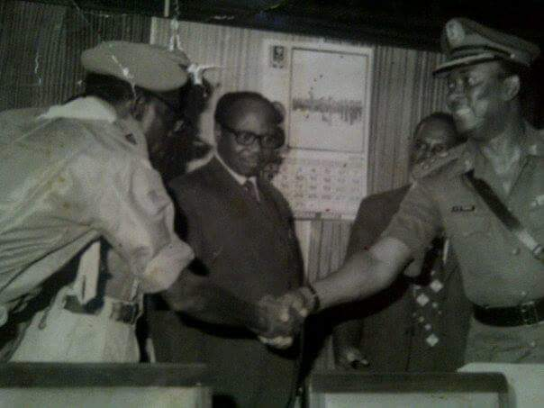 Chief Olu Akinnola, introducing someone to the then visiting military Governor of the Western State..jpg
