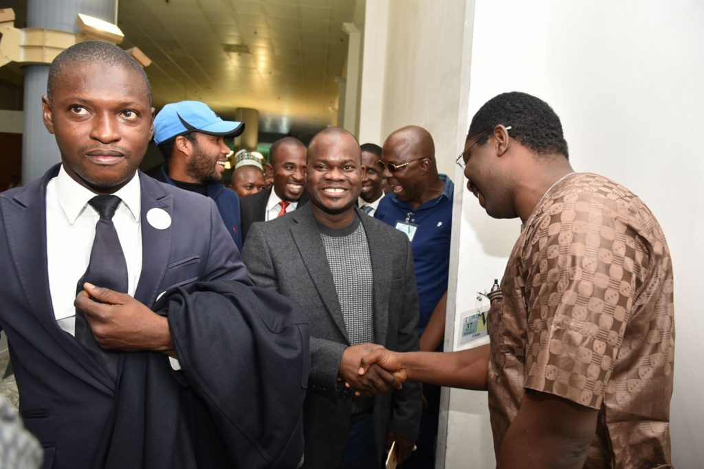 Gov. Bello greets a well wisher on his return to Nigeria