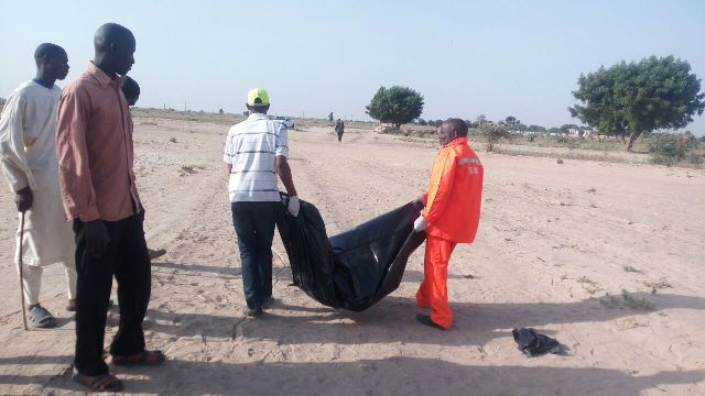 The remains of the suicide bomber being evacuated