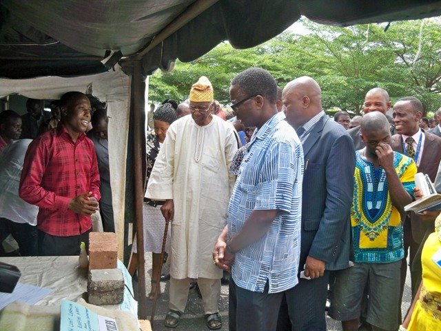 Paul Gbedebo and others listening to the process of making fibre concrete