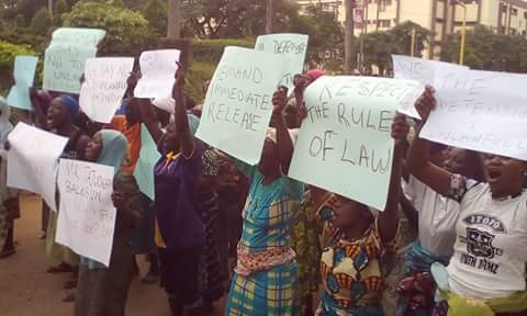 Relations of the 10 labourers protesting their alleged unlawful arrest and detention in front of NSDCD gate at Alausa, Ikeja before they were eventually released.