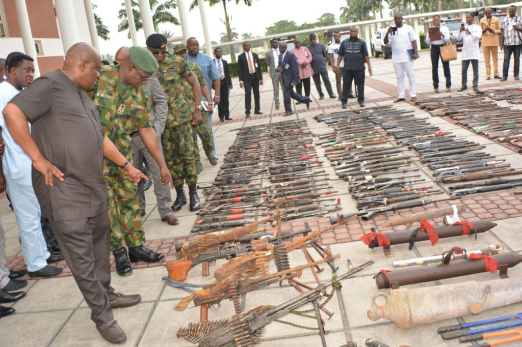 Rivers State Governor , Nyesom Ezenwo Wike and service commanders inspect assorted arms and ammunitions  recovered in  the  course of the Rivers State Amnesty Programme at the Government House , Port Harcourt on Tuesday .