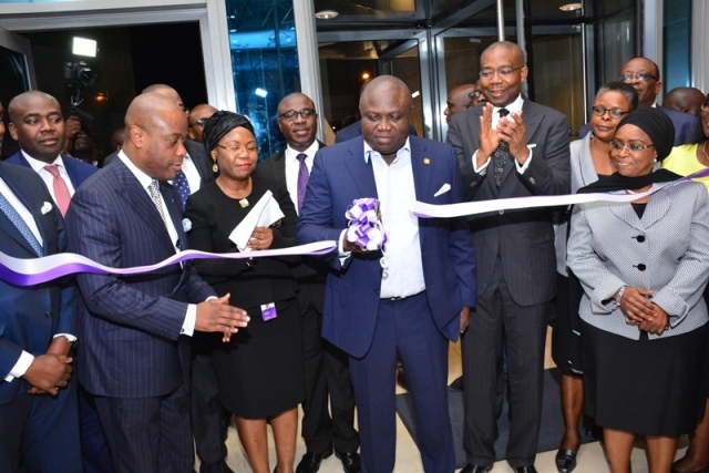 Lagos State Governor, Mr. Akinwunmi Ambode (middle); cutting the tape to commission the Wapic Insurance Plc. Head Office at Ikoyi during, on Monday, November 21, 2016. R-L: With him are Chairman, Access Bank, Mrs. Mosun Belo-Olusoga; Chairman, Board of Directors, Wapic Insurance Plc., Mr. Aigboje Aig-Imoukhuede; Managing Director of Wapic, Mrs. Adeyinka Adekoya and Group Managing Director, Access Bank, Mr. Herbert Wigwe.