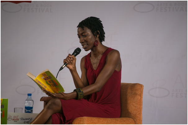 Omotoso, reading a passage from The Woman Next Door. Photograph: Ake Arts and Book Festival