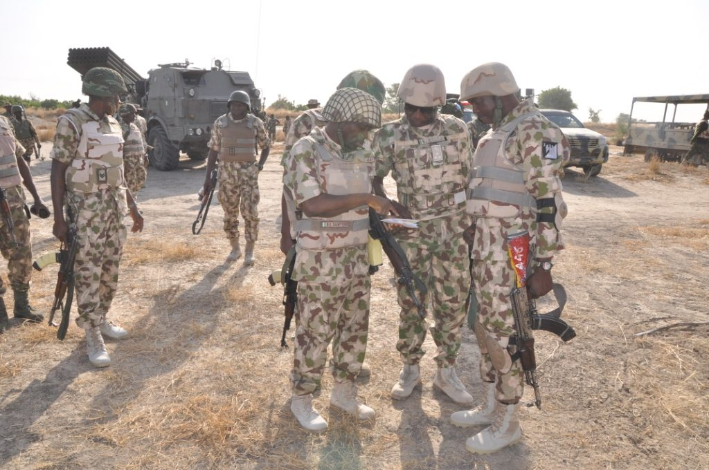 The troops, led by Commander Ezegwu plotting their strategy
