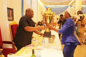 Gov. Wike receiving the trophy from captain of the team