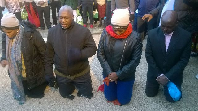 Achuba (second from left) and the other pilgrims at the prayer ground
