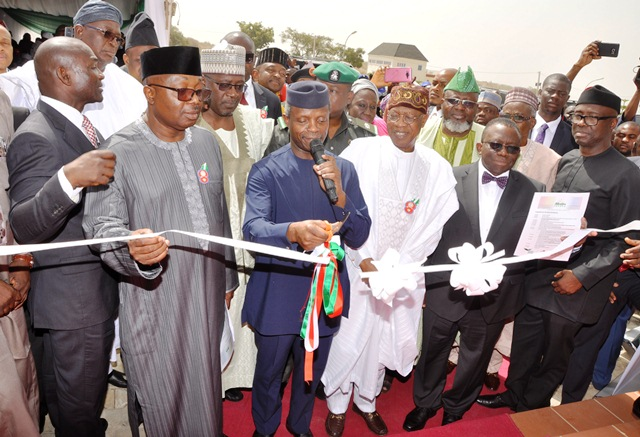 VP Osinbajo commissioning  Abuja Digital Switch Over at the offices of Signal Distributor Pinnacle Communications Ltd. He is flanked on the right by Mohammed and on the left by Chairman of Pinnacle Comm. Lucky Omoluwa
