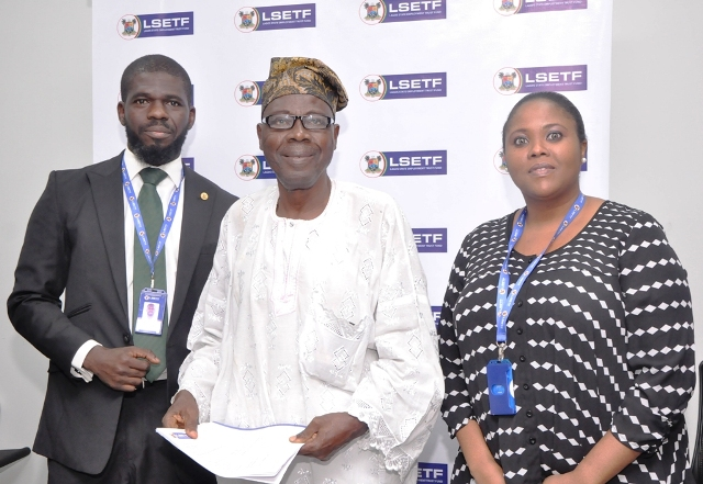 L-R: Executive Secretary, Lagos State Employment Trust Fund (LSETF), Mr. Akin Oyebode; Successful Applicant of the Employment Trust Fund, Mr. Ganiyu Ayantunde and Director, Strategy Funding & Stakeholder Engagement, LSETF, Mrs. Abosede Alimi during the distribution of Offer Letters to beneficiaries of the N25 Billion Employment Trust Fund (ETF) Pilot Scheme at the LSETF Office, Oregun, Ikeja, on Friday, December 30, 2016