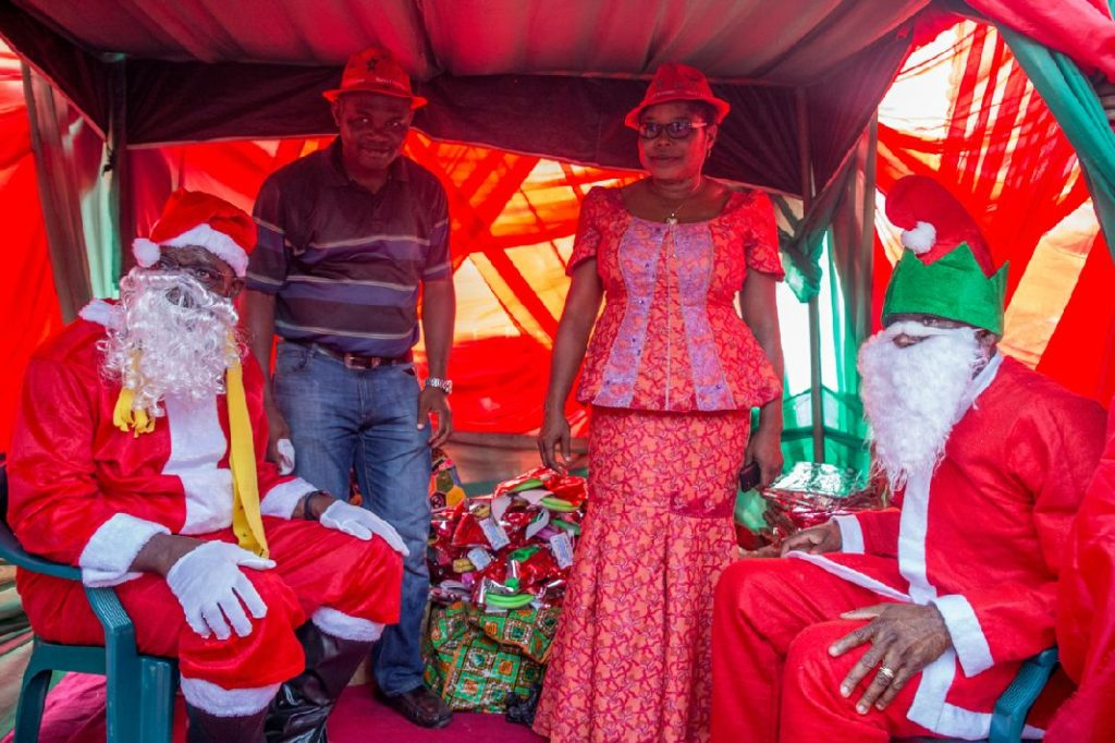 Governor Godwin Obaseki (Left) and Rt. Hon. Comrade Philip Shaibu, Deputy Governor (Right) as Father Christmas at the IDP Children Christmas party