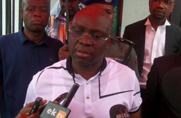 Governor, Ayodele Fayose, on Thursday stormed the Ado Ekiti Branch of Zenith Bank to withdraw N5m cash. Photo credit: Premium Times