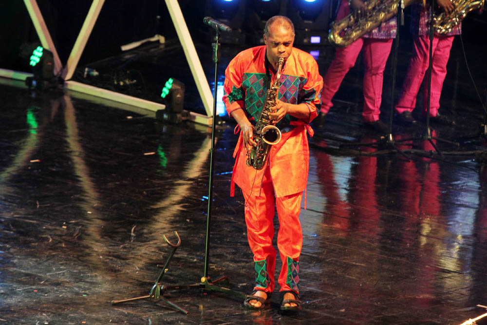 Afro beat musician, Femi Kuti blowing his lungs out to entertain guests at the award ceremony