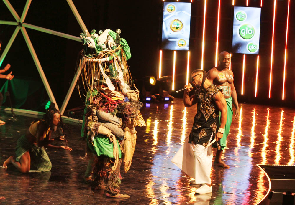 Nigerian pop act, Flavour surprised all when he brought a masquerade on stage to pep us his performance