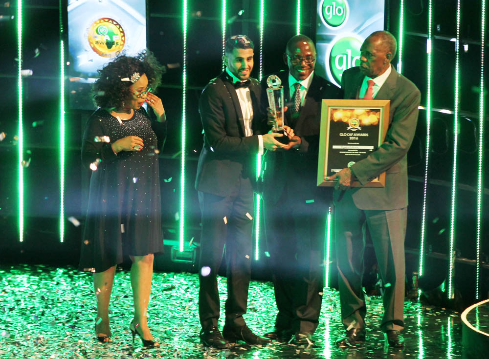 From Left -Director of Globacom, Gladys Talabi, Nigeria's  Minister of Sports, Solomon Dalung, President CAF,  Isa Hayatou presents  African Football Player of the Year award to Riyad Mahrez (second left)
