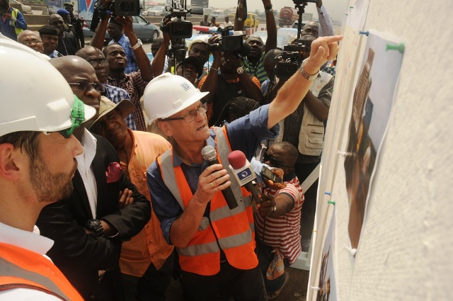 Hon. Minister of Power, Works and Housing, Mr Babatunde Fashola, SAN (left) being briefed by the Federal Controller of Works Lagos State, Engr. Godwin Eke (middle) and Project Manager of Julius Berger Nigeria Plc, Mr Wolfgang Panzer (right) during the Minister's inspection of the completed Phase One of the rehabilitation of the Long Bridge after 40 years of use as part of the reconstruction and rehabilitation of the Lagos-Ibadan Expressway by the Federal Government on Monday 12th December, 2016.