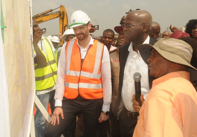 Hon. Minister of Power, Works and Housing, Mr Babatunde Fashola, SAN (middle) being briefed by the Federal Controller of Works Lagos State, Engr. Godwin Eke (right) and Commercial Manager of Julius Berger Nigeria Plc, Mr Hans Meletschus (left) during the Minister's  inspection of the completed Phase One of the rehabilitation of the Long Bridge after 40 years of use as part of the reconstruction and rehabilitation of the Lagos-Ibadan Expressway by the Federal Government on Monday 12th December, 2016.