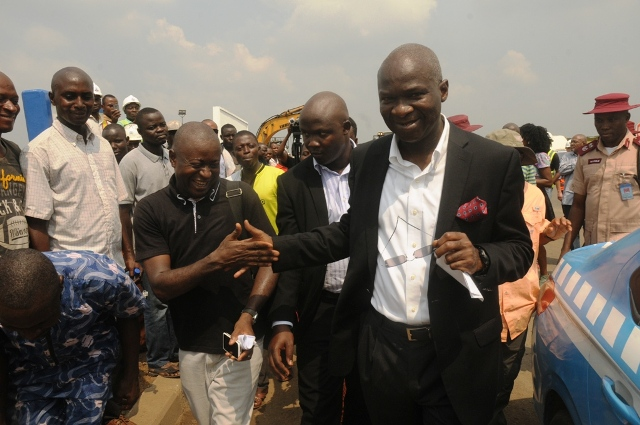 Hon. Minister of Power, Works and Housing, Mr Babatunde Fashola, SAN (right) being congratulated by a journalist and resident of one of the adjoining communities, Mr Kelvin Okunbor   (left) and others shortly after the Minister's inspection of the completed Phase One of the rehabilitation of the Long Bridge after 40 years of use as part of the reconstruction and rehabilitation of the Lagos-Ibadan Expressway by the Federal Government on Monday 12th December, 2016.