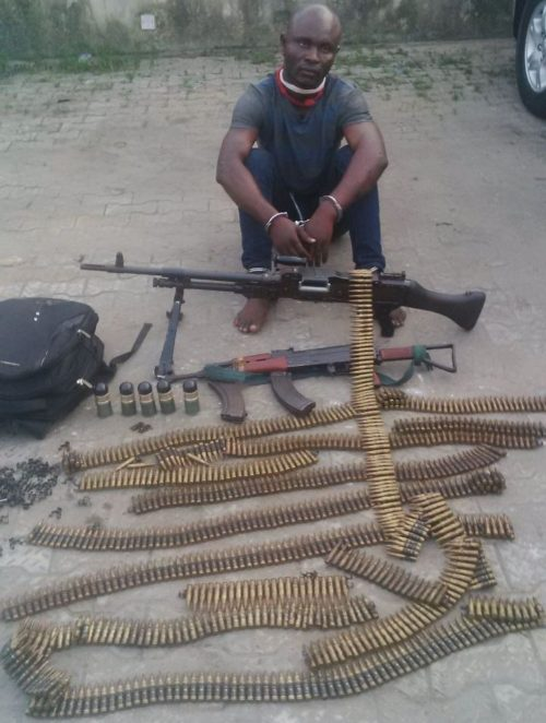 James and the weapons recovered from his gang