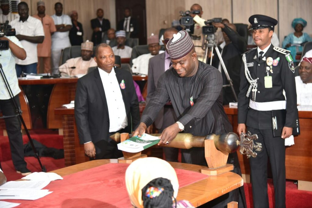 Governor Yahaya Bello lay the budget document on the table after presenting it to Kogi House of Assembly
