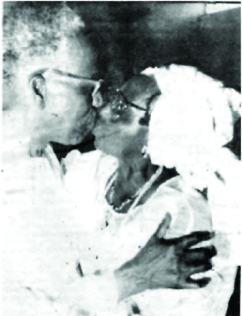 Obafemi and Hannah Awolowo kissing for the first and only time publicly