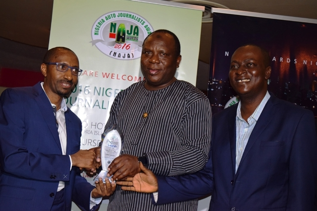 From right, Chairman, Auto Journalists Association of Nigeria, Frank Kintum, Acting Commissioner for Transport, Lagos State, Prince Anofi Elegushi presenting the best car of the year Peugoet 301 award to the Managing Director, Peugeot Motors Mr. Ibrahim Boyi