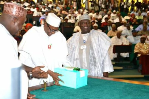 President Buhari lay the 2017 Budget document on the table after presenting it to lawmakers (Photo Femi Ipaye)