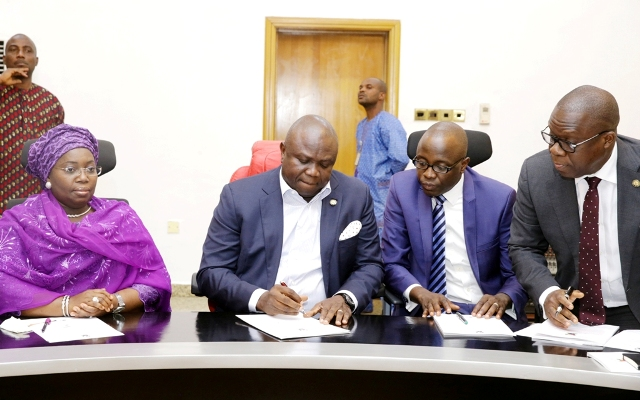 Lagos State Governor, Mr. Akinwunmi Ambode (2nd left); Deputy Governor, Dr. (Mrs.) Oluranti Adebule (left); Commissioner for Finance/Economic Planning & Budget, Mr. Adeyemi Ashade (2nd right) and Attorney General & Commissioner for Justice, Mr. Adeniji Kazeem during the signing of N47 Billion Bond Deal with Issuing Houses at the Banquet Hall, Lagos House, Ikeja, on Friday, December 30, 2016.