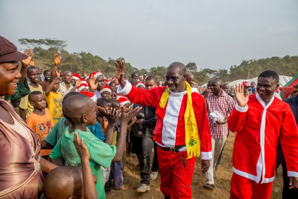 Governor Godwin Obaseki (Left) and Rt. Hon. Comrade Philip Shaibu, Deputy Governor (Right) waving to the children at the IDP children Christmas party