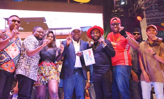 Lagos State Governor, Mr. Akinwunmi Ambode (middle), with Rap star, Folarin 'Falz' Falana (3rd right); Singer & Songwriter, Niniola Apata (3rd left) Pop Artist, Azadus (2nd left); Hip Juju Artist, Wale Thompson (left); Viktoh of YBNL (right) and others during the One Lagos Fiesta at the Ikorodu Town Hall, Lagos, on Tuesday, December 27, 2016.