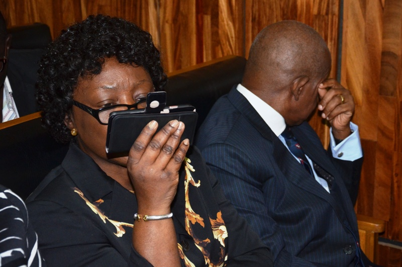Justice Ademola and wife trying to avoid camera in court Photo: FEMI IPAYE
