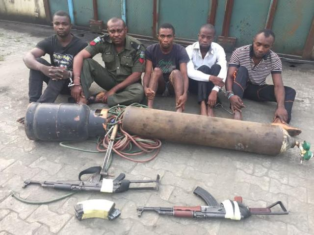 The suspects and the tools for the robbery recovered from them
