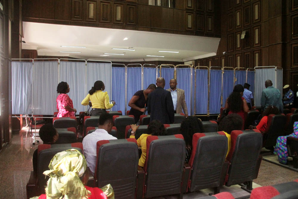 Inside the court room: Witnesses, lawyers, judge and the defendants shielded from journalists and few others allowed inside.
