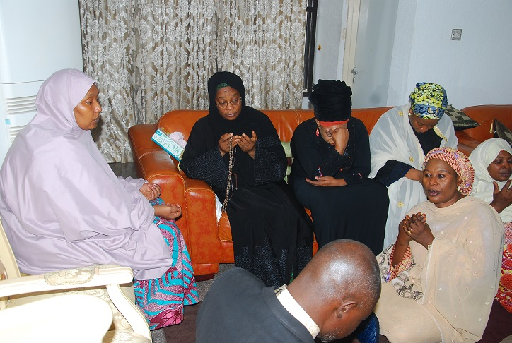 Wife of the deceased, Senator Zainab Kure (second left) with sympathisers during the burial prayer