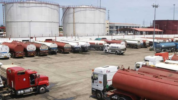 Petrol tankers at a depot: NUPENG threatens to stop distribution of petroleum products across Nigeria on Monday