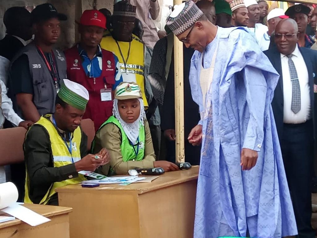 President Buhari undergoing accreditation before voting in Daura during the 2019 general elections. Nigeria will go to polls to elect his replacement in 2023