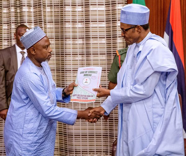 President  Buhari receiving Assets Declaration Forms from the Code of Conduct Bureau Chairman, Prof. Mohammed Isah, at the Presidential Villa, Abuja.