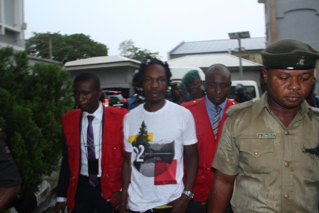 file photo: Naira Marley in court with EFCC operatives