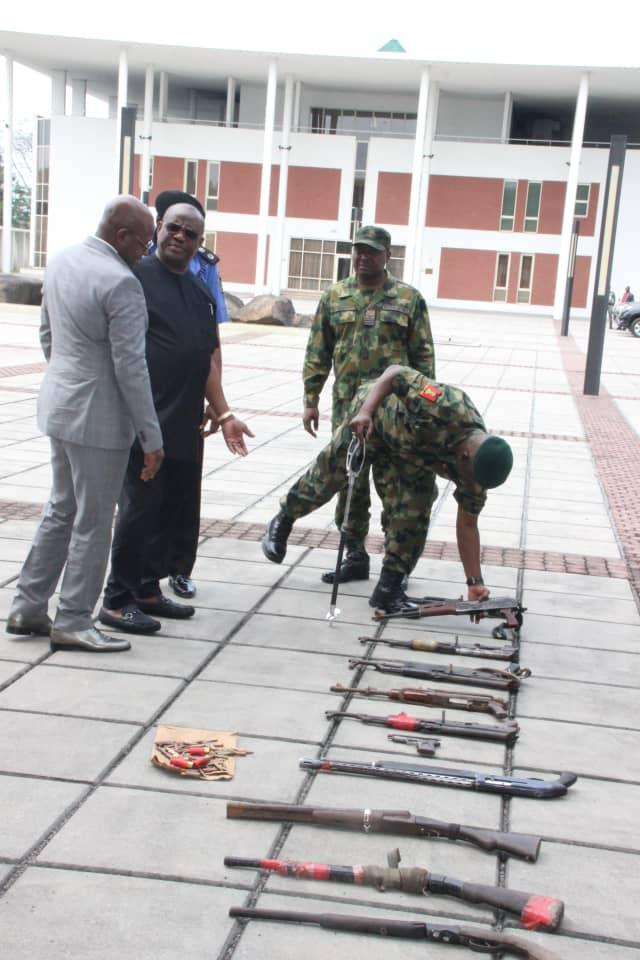 Pictures 1 and 2: Rivers State Governor, Nyesom Ezenwo Wike (2nd L) and Service Commanders during the submission of Arms surrendered by repentant criminals at the Government House Port Harcourt on Tuesday