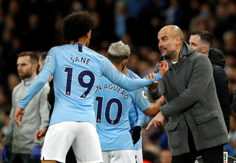 Manchester City's Gabriel Jesus comes on as a substitute to replace Sergio Aguero as manager Pep Guardiola gives instructions to Leroy Sane REUTERS/Phil Noble