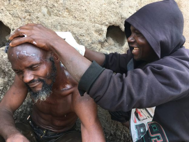 One of the mentally challenged persons having a hair cut during the monthly clean up in Kaduna