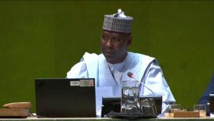 Muhammad-Bande presiding at the opening session of the 74th GA.