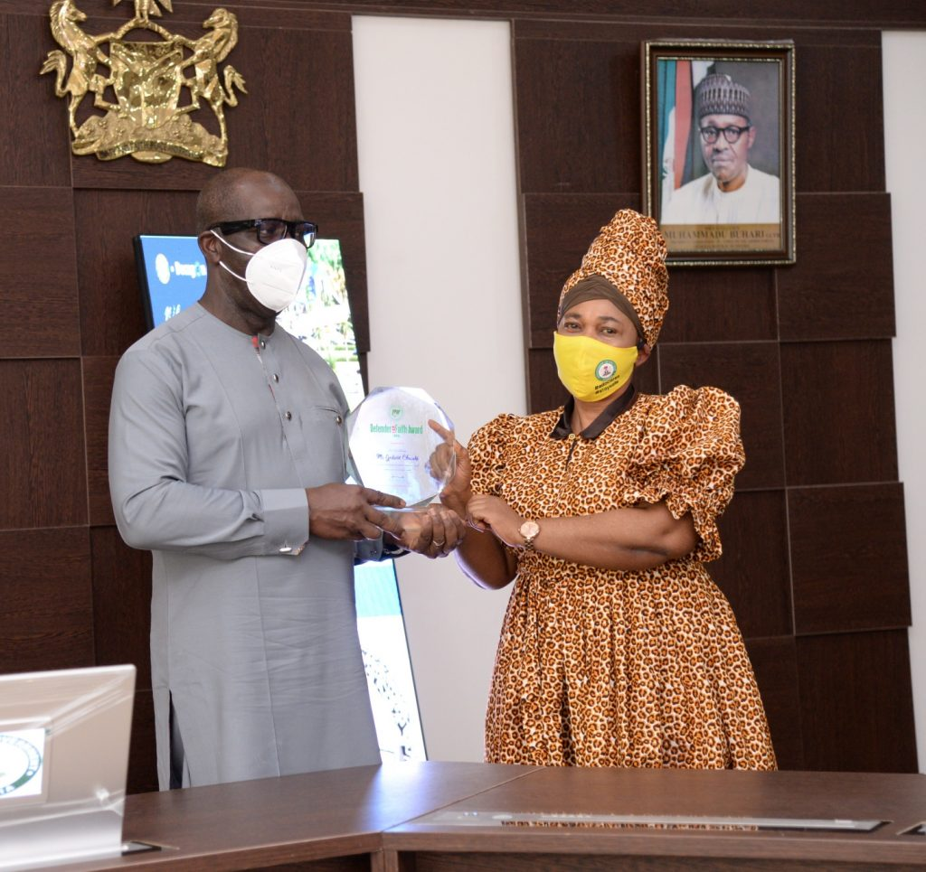 Chairman of PFN, Edo state chapter, Pastor (Dr.) Margaret Agbonifo presenting the award to Governor Obaseki