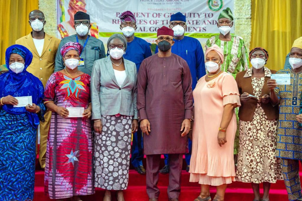 Governor Abiodun and some of the pensioners with their cheques