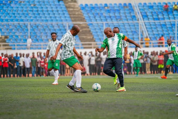 Governor Yahaya Bello tackles one of the players during the novelty match