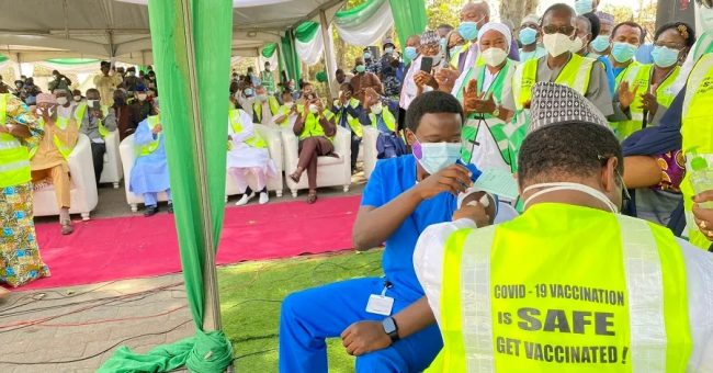Dr Cyprian Ngon, a medical doctor with National hospital Abuja, taking the first shot of COVID-19 administered in Nigeria. National Primary Health Care Development Agency (NPHCDA) says 4,680,000 Nigerians have so far been vaccinated against COVID-19 .