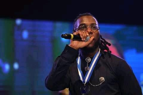 Burna Boy performing at the event