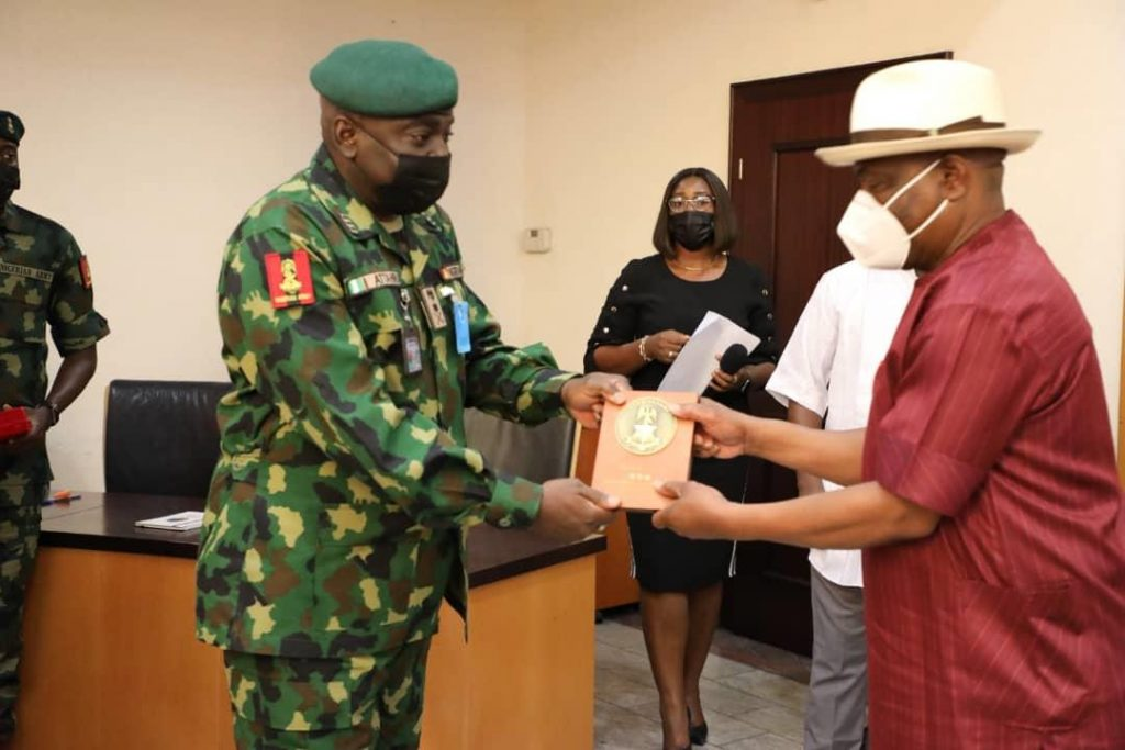 Governor of Rivers State, Nyesom Ezenwo Wike (right) receives  a plaque from Chief of Army Staff, Lt. General Ibrahim Attahiru during the latter's courtesy call  at the Government House, Port Harcourt on Tuesday.